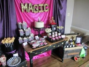 Magic cake, cupcakes, and candy layout in a magic theme.